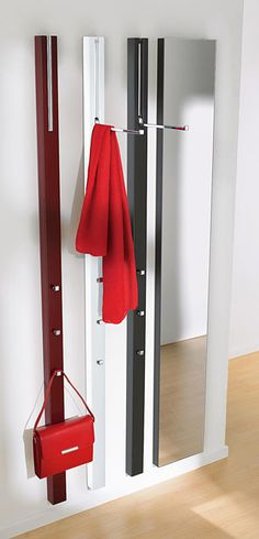For narrow entryways, fold-down hooks like these from TopDeq are a good solution. You just fold the hooks up out of the way when not in use.