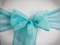 Chair Rentals- Ocean Organza Chair Sash. Complete the look with a matching table runner or napkin. Check out our other fabrics at Eventrentalutah.com or follow our board on Pinterest