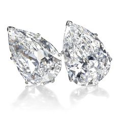 Jewels for Hope: The collection of Mrs Lily Safra - A pair of pear-shaped diamond earrings weighing 19.16 & 19.43 carats, each of D color #christiesjewels