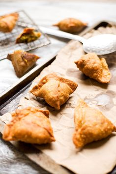Indian Pastry: Samosa (Fried, or baked triangular-, semilunar- or tetrahedral-shaped shell with filling of spiced potato, onion, coriander, lentil, peas, or ground chicken or lamb).