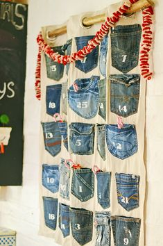 Recycle your families old jeans pockets into a fabulous handmade advent calendar. Really simple step by step tutorial with no sewing involved. Jean Crafts, Denim Crafts, Upcycled Crafts, Christmas Sewing, Christmas Crafts, Christmas Decorations, Xmas, Christmas 2017, Christmas Ideas
