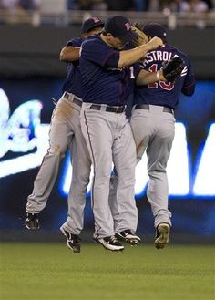 Minnesota Twins outfielders Josh Willingham, Ben Revere and Darin Mastroianni (19) celebrate following a baseball game against the Kansas City Royals at Kauffman Stadium in Kansas City, Mo., Wednesday, June 6, 2012. The Twins defeated the Royals 4-2