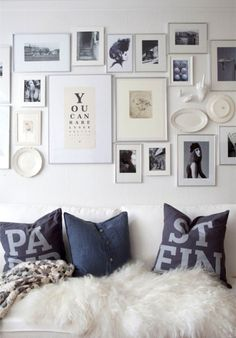 Love the wall collage with a mix of framed pictures & plates!!