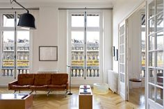 dream apt. natural leather and wood on a white background. in Paris.