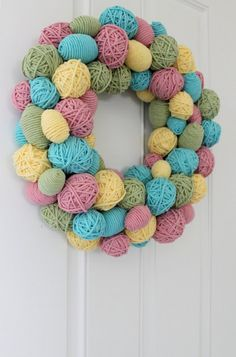 Easter Wreath using plastic eggs and yarn...love it but on a smaller scale! Egg Decoration| Bunny Accessories| Easter Food| Cookie Recipe| DIY decoration| Repin it