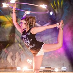 Shellie White Light performing double fire hoops during a Medicine for the People show in Australia