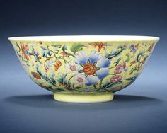 A fine famille rose yellow-ground bowl.Qianlong seal mark and of the period .