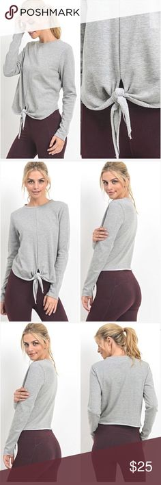 """Adorable Gray Tie Waist Sweatshirt Top SML How cute is this little top?!  Perfect on its own or layered over a cami. Heather gray cotton/poly blend with stretch. Waist length with a tie accent for a little sassy.   Small 2-4 Bust 32-34 Length 21"""" Medium 6-8 Bust 36 Large 10-12 Bust 38 Tops"""