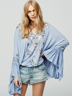 Siren Song Top | Embroidered with a beautiful and colorful floral design this flowy top features a V-neckline with adjustable tie detailing.  Boho wide sleeves with flared ruffle cuffs and an elastic waistband.