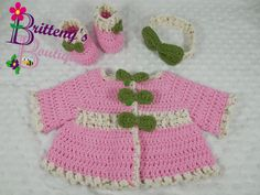 I love how the green bows pop against the pink of this sweater!!!  The baby yarn is so soft in this sweater, but it's a heavy yarn, and the stitching makes it super warm for an outing on a cool day.  This set includes a few of my favorite special features! Under each of the bows on the sweater, you will find a hidden BUTTON!!