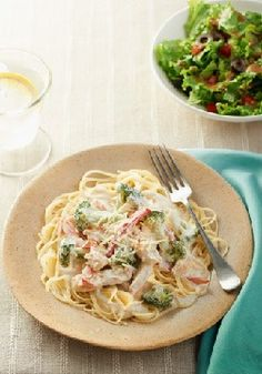 Chicken Capri Pasta – heavenly may just be the way you describe this silky-creamy angel hair pasta dish that's studded with chicken and fresh vegetables.