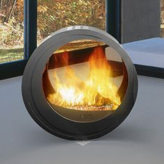 Modern Mobile fireplace - can be used inside or out.  How cool is that?!