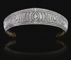 A Diamond Kokoshnik Tiara, Circa 1910        Designed as a series of radiating scrolls surrounding three principle pear-shaped diamonds set with circular-cut, rose-cut, and cushion-shaped stones, framed by two lines of similarly-set diamonds. (Sold for $339,367)