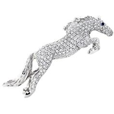 White Gold Diamond and Sapphire Horse Pin | From a unique collection of vintage brooches at http://www.1stdibs.com/jewelry/brooches/brooches/