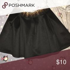 black high waisted skirt . black high waisted skirt with a cheetah elastic at the top. Skirts