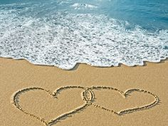 Romantic Sea Background with Hearts in the Sand