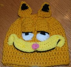 I love this crochet hat! Garfield hat - Crochet Me ~ Link correct and pattern is FREE when I checked on March 2015 USA terminology Child to adult sizes Crochet Kids Hats, Crochet Cap, Crochet Crafts, Crochet Clothes, Crochet Projects, Free Crochet, Knitted Hats, Crochet Character Hats, Just In Case
