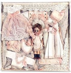 """German Bisque Doll  — 5"""" Miniature Doll in Trousseau Presentation for the French Market in 10"""" x 10"""" Box,   c.1895   (750x778)"""