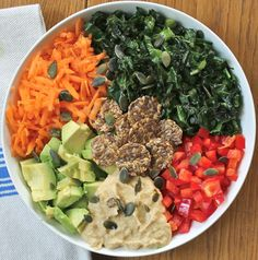 A Simple Rainbow Salad with the Most Delicious Hummus Dressing Recipe Salads with kale, red pepper, avocado, carrots, pumpkin seeds, hummus, water, hummus, almond butter, honey, apple cider vinegar, tahini, salt