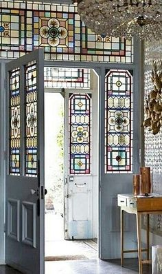 What a door~ I will do something like this for my house.replace the half moon window above the front door with stained glass.