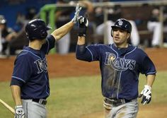 The Rays go ahead 1-0 as Matt Joyce, right, with Ben Zobrist, scores on a hit by B.J. Upton in the third inning. The Rays beat the Miami Marlins 5-1 & are back alone in first place in AL East. (6-9-12) game 58