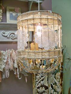 Repurposed  bird cage into a pendant light.