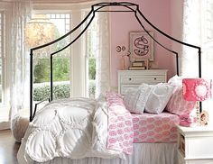 Stylish Bedding for Teen Girls...love the pink, white and blk canopy bed