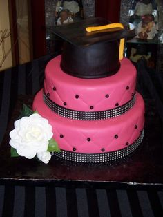 Graduation Cake:  Maybe round cakes frosted orange with blue top layer cap