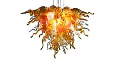 This eclectic chandelier featuring multiple whimsical organic shapes in shades of amber is as visually exciting as a piece of contemporary art. Due to the handmade nature of this piece, variations...