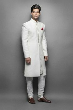 Cream silk sherwani paired with Gold Color kurta