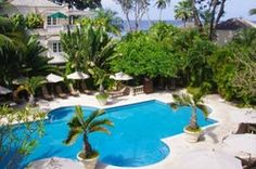 Coral Reef feature 88 rooms cottages and suites set amidst 12 acres of beautiful landscape gardens... Spacious,   individually designed interiors Crisp, white Egyptian cotton bed linen, feather beds