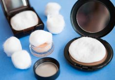 Makeup cotton balls and cotton pads to protect powders from breaking.
