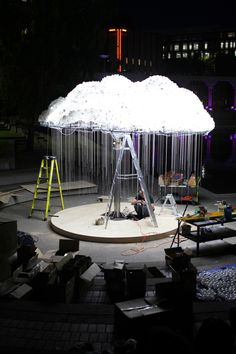 CLOUD is a large-scale interactive installation, made of 5000+ both illuminated and burnt out light bulps,   CLOUD asks the viewer to participate by experiencing the work first hand – standing beneath the structure and pulling lights on and off, creating the flickering aesthetic of an electrical cloud.  Made by Caitlind r.c. Brown