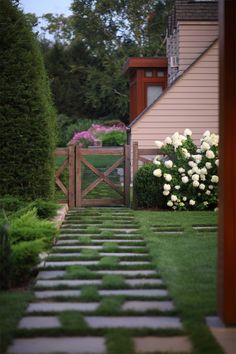 Love this path leading to a beautiful stylish fence.
