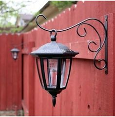 Hang dollar store solar lights on basket hooks.