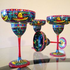 i could make these  dollar tree margarita glasses  painted