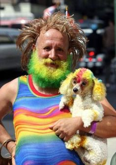 This man who dyed his poodle to match his beard: The dog looks more baked than the guy does...