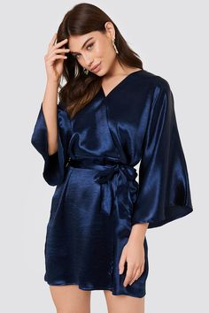 The Leja Shiny Dress by Rut&Circle features a wrap-neckline, wide sleeves, a cinched waist with a self-tie, and a silky material. Team Bride, Nightwear, Kimono, Neckline, Sleeves, How To Wear, Outfits, Clothes, Dresses