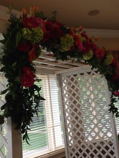 Arch flowers with lush mix greens and green hydrangeas, roses, Gerbera daisies