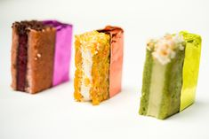 Colorful mini ice cream sandwiches in flavors such as pistachio coconut pineapple and carrot butter pecan caramel served in matching foil, by Abigail Kirsch Catering in New York Photo: Andre Maier