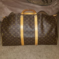 Louis Vuitton Keepall 55 Great bag for traveling with. There is normal wear.The Patina has darkened from use.  Date Code in picture 4 is SD842. Note the  zipper broke, so it does need a new zipper that Louis Vuitton will replace. FOR SALE ONLY. NO TRADES.  Thank you for looking at my closet. Louis Vuitton Bags Travel Bags