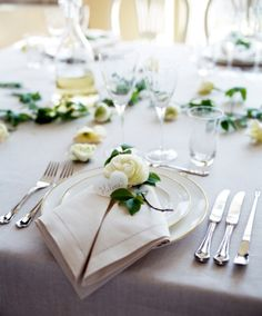 Cream and gray table setting, beautifully folded napkins with floral accents
