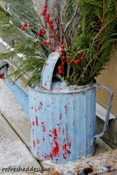 Greenery in a watering can. Must do this on the front porch for Christmas and leave through winter. Love this idea! and already have the can
