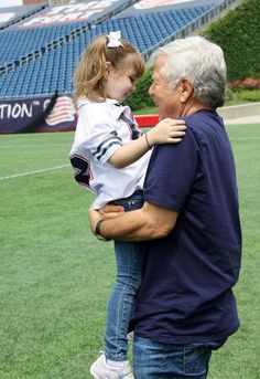 Patriots owner Robert Kraft greets an Andruzzi Foundation beneficiary - 5-year-old cancer survivor, Jackie.