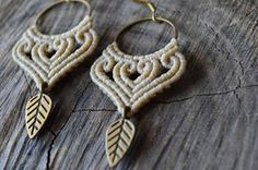 Macrame earrings with brass hoops with brass leaf   Boho - Hippie beige macrame earrings The metal components are all high quality brass and the cord is waxed. The size of the earrings is: - Width: 3 cm - Lenght: 5.5 cm For a different colour, please contact me with a convo and have something made just for you! See more earrings here: https://www.etsy.com/shop/IndigoMacrame?ref=hdr&section_id=19648964 Visit the shop here: https://www.etsy.com&#x...