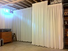 AFTER: Main area of our unfinished basement behind those curtains is the laundry area oh yeah, tha...