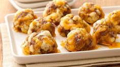 Sausage Crescent Cheese Balls Recipe Appetizers with spicy sausage, shredded sharp cheddar cheese, dri leav rosemari, Pillsbury™ Refrigerated Crescent Dinner Rolls, all-purpose flour