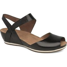 The Dansko Vera Peep Toe Sandal gives you the best of both worlds by combining the look of a wedge and the comfort of a flat. The stained cork midsole and a rubber outsole complement each other Low Wedge Sandals, Black Sandals, Women's Shoes Sandals, Women Sandals, Sandals Outfit, Open Toe Shoes, Ciabatta, Womens High Heels, New Shoes