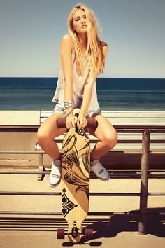 Chilling on the beach with a longboard                                                                                                                                                       More