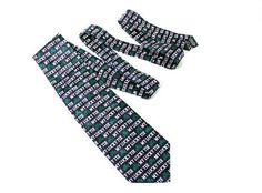 "This great novelty tie features a dark navy colored tie with an all over pattern of Shamrocks and the words ""My Lucky Tie"". It makes a great Father's Day gift or is perfect for St. Patrick's Day! Tie measures approximately 3-3/4"" wide at it's widest point. Made of 100% Polyester for easy cleaning of any spills!"